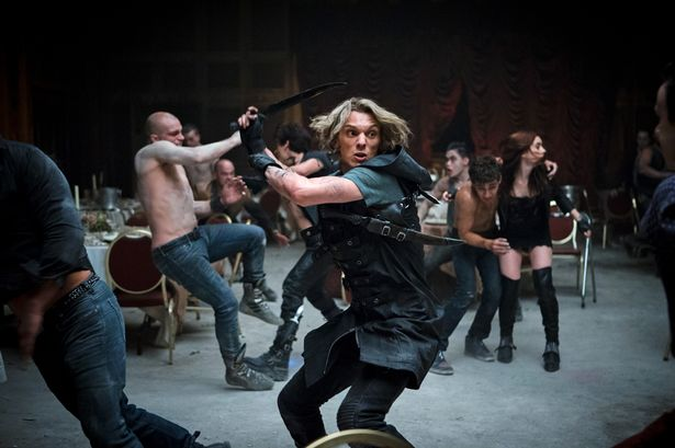 Jace-Jamie-Campbell-Bower-takes-on-the-Vampires-in-The-Mortal-Instruments-City-of-Bones-2206543